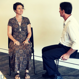 Rachel being hypnotised at a hypnotherapy training workshop by a student